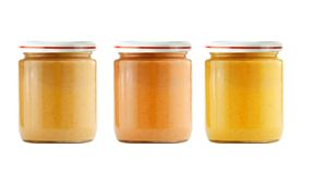 Jars of baby puree isolated on white Stock Photography