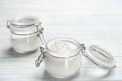 Jars with baking soda. On white wooden background stock images