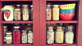 Jars of beans and popcorn Royalty Free Stock Images