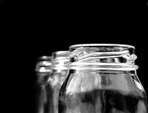 Jars on black Royalty Free Stock Photos