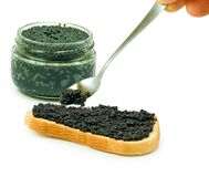 Jars with black caviar and bread with black caviar Royalty Free Stock Photo