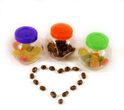 Jars with candies and chocolate heart Stock Image