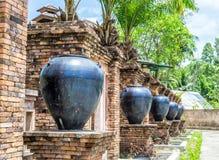 Jars of clay brick walls Royalty Free Stock Images