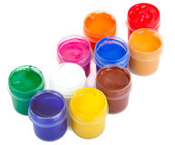 Jars with colored gouache. On white background Stock Images