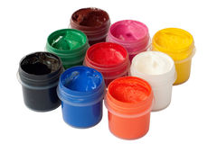 Jars with colored gouache Royalty Free Stock Photos
