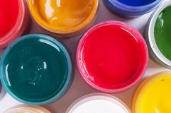 Jars with colored gouache Stock Image