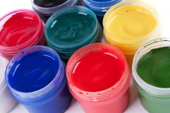Jars with colored gouache Royalty Free Stock Image