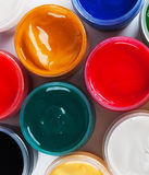 Jars with colored gouache Royalty Free Stock Images