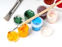 Jars with colored gouache paints Royalty Free Stock Image