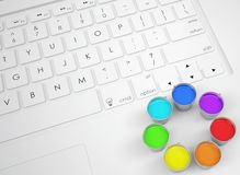 Jars with colored inks on the keyboard Royalty Free Stock Photos