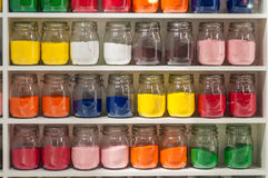 Jars of Colored Sand. Individual Jars of Brightly Colored Sand on Shelf Royalty Free Stock Photography
