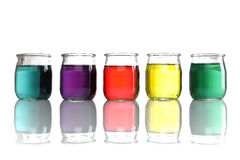 Jars of colored water stacked Stock Photos