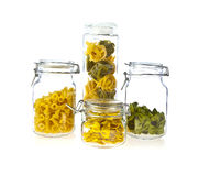 Jars of coloured pasta Royalty Free Stock Photo