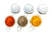 Jars of colourful ground spice Royalty Free Stock Image