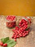 Jars with cornelian cherries fruit Royalty Free Stock Photo