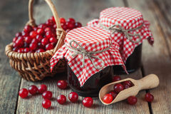Jars of cranberries jam and basket with bog berry Royalty Free Stock Image