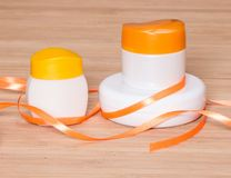 Jars of cream with satin ribbon Royalty Free Stock Images