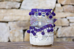 Jars  decorated with  lace on a stone background .Home decoration Stock Photography