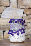 Jars  decorated with  lace on a stone background .Home decoration Stock Photo