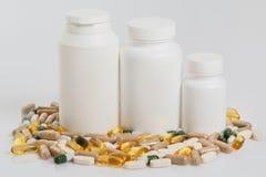 Jars and different pills Stock Photos