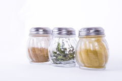 The jars with different spices. Glass jars of different spices on a white background Royalty Free Stock Photography