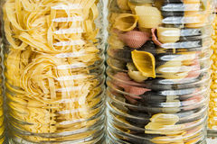 Jars with different types of colored pasta and spaghetti - close view Royalty Free Stock Photo