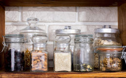Jars with dried fruits and nuts Stock Images