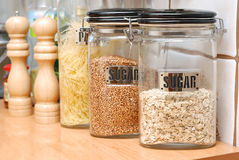 Jars with food. Cereals and pasta in the kitchen Royalty Free Stock Photography