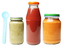jars of food and bottle of juice for babies Stock Images