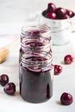 Jars with freshly homemade cherry jam Stock Photo