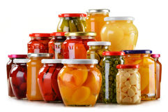Jars with fruity compotes jams and pickled vegetables isolated Royalty Free Stock Photo