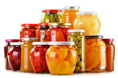 Jars with fruity compotes jams and pickled vegetables. On white background. Preserved fruits Stock Photos