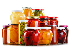 Jars with fruity compotes jams and pickled vegetables Royalty Free Stock Images