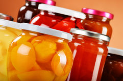 Jars with fruity compotes and jams. Preserved fruits Royalty Free Stock Photos