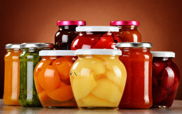 Jars with fruity compotes and jams. Preserved fruits Stock Photography