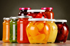 Jars with fruity compotes and jams. Preserved fruits Royalty Free Stock Photo