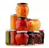 Jars with fruity compotes and jams. Preserved fruits Royalty Free Stock Images