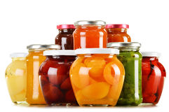 Jars with fruity compotes and jams on white. Background. Preserved fruits Royalty Free Stock Image