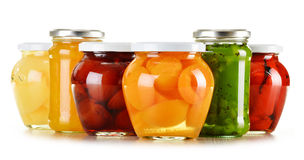 Jars with fruity compotes and jams on white Stock Photos