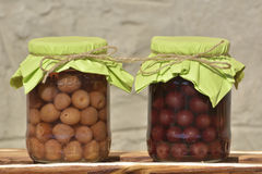 The Jars with fruity compotes . Preserved fruits. Jars with fruity compotes . Preserved fruits Stock Images