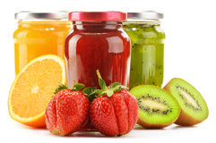 Jars of fruity jams on white. Preserved fruits Royalty Free Stock Photos