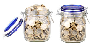 Jars full of coins Stock Images