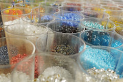 jars full of colored beads Stock Photo