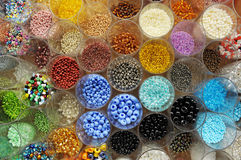 Jars full of colored beads Stock Photos