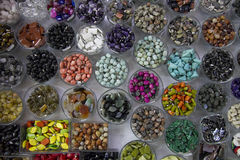 Jars full of colored beads Stock Images