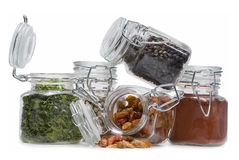 Jars full of spices. Some jars with spices isolated on a white background stock image