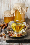 Jars and glass jug of honey on wooden table Royalty Free Stock Photo