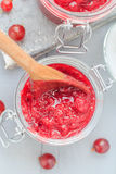 Jars gooseberry jam wooden table Royalty Free Stock Photography
