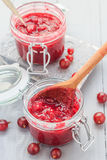 Jars gooseberry jam wooden table Royalty Free Stock Images