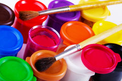 Jars of gouache and brush Stock Images